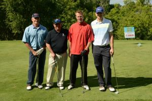 Mark Suckle (2nd from left) with his team at the 2013 tournament