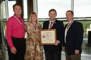 Jason Scott (left) receiving his Fellow designation at the 2014 Annual Meeting with other Fellow recipients Brenda DeBastiani, Bruce Hammond, and Jason Newmark.